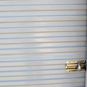 A locked sliding garage door on a self storage unit in Springville, UT