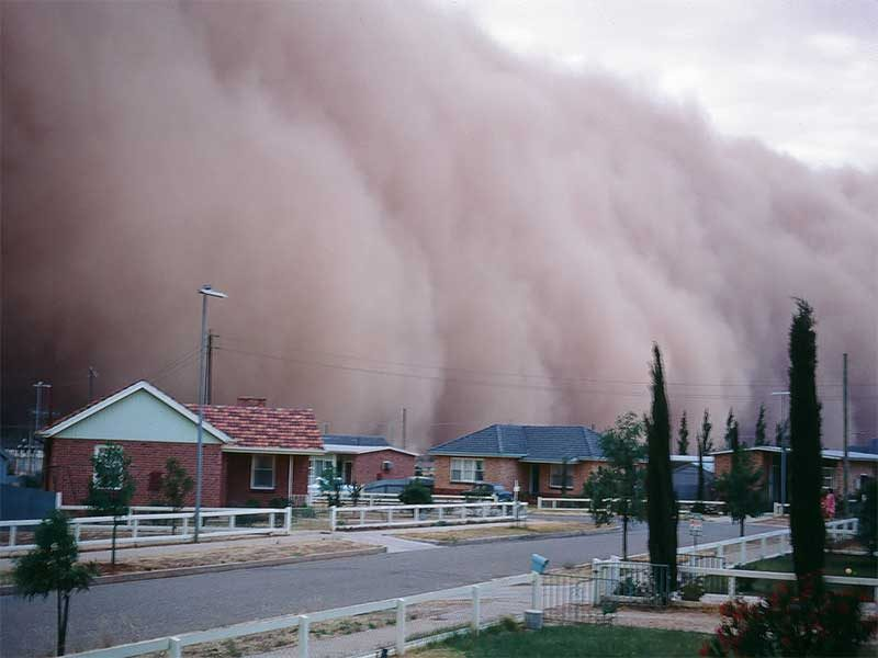 dust storm moving into a town